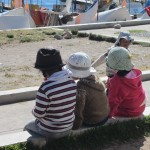 Children wearing their sunhats near Lake Titicaca