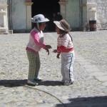 Local children meet outside the chuch
