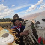 Lewis meets a llama, a sheep and a traditionally dressed Peruvian