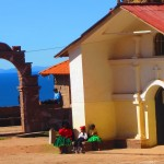 Locals hang out near the church