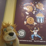 Lewis the Lion laughs at the funny bagel poster