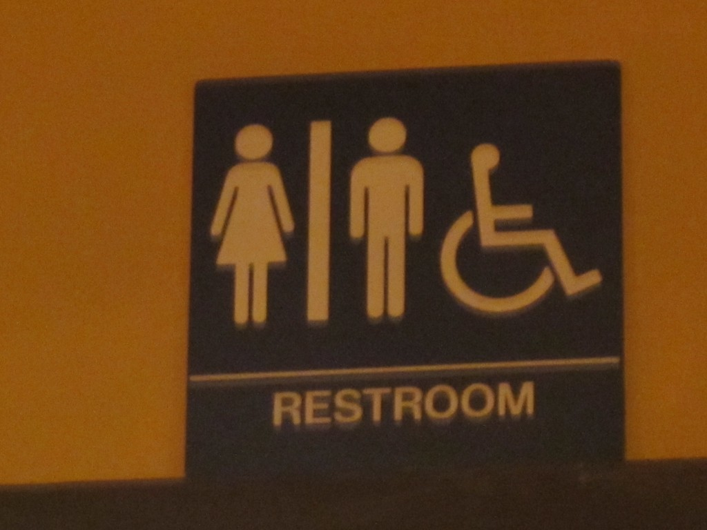 A sign for the restroom - the toilets