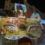 A light projection of a Venetian mask on the building