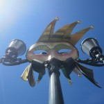 A typical Venetian mask on the lamp-posts