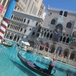 The gondoliers ride past in this fake Venice