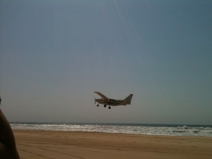Helen takes a photo of Lewis' plane as it takes off over Fraser Island