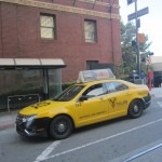 A yellow taxi cab