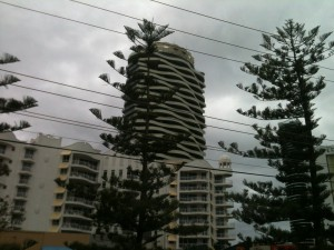 Tall apartment blocks run all along the coast