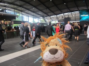 Lewis the Lion sees the elegant throng at the train station