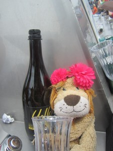 Lewis the Lion cheekily pretends to drink champagne!