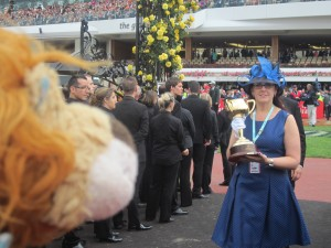 The Emirates Melbourne Cup is carried right past Lewis the Lion