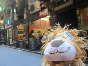 Lewis the Lion discovers little hidden away lanes full of cafes and bakeries