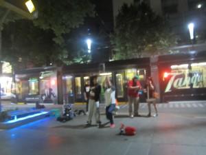 Hip-hop dancers entertain the passing crowds