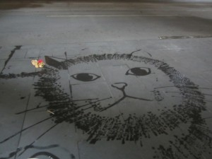 Lewis the Lion loves this pavement cat!