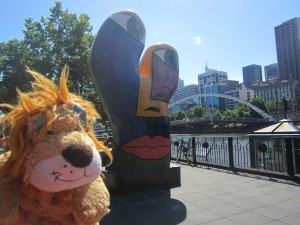 Lewis the Lion loves the piece of modern art by the river