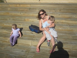Helen plays with Tommy and Estelle by the seaside