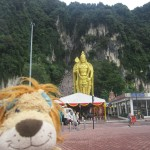 Lewis the Lion gets some perspective on the site of the Batu Caves