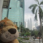 Lewis the Lion sees the Petronas Twin Towers in the distance