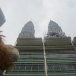 Lewis the Lion cranes his neck to look at the towering skyscrapers