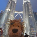 Lewis the Lion admires the way the Petronas Towers are lit up in the evening