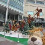 Lewis the Lion sees Santa's sleigh by the Petronas Towers