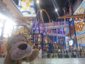Inside the Times Square shopping mall with its roller coaster