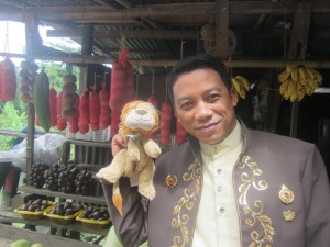 Prince Rendy with Lewis the Lion at the fruit stall