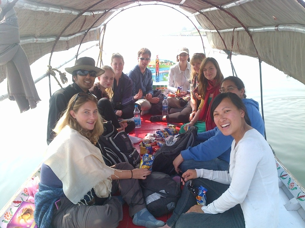 A picnic on the boat to the Kumbh Mela