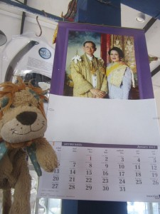 Lewis the Lion next to a royal calendar in a Thai shop