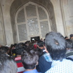 The crowds swarm to enter the Taj Mahal