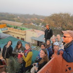 The group admire the view of the Taj Mahal from a cafe rooftop