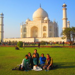 Helen and her friends sit in the Taj Mahal Gardens