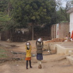 Children carry waterpots home