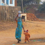 A mother fetching water