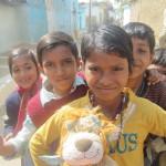 Local children greet Lewis the Lion