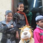 Lewis meets some of the weavers children in Varanasi