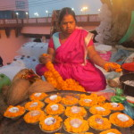 A candle-flower seller on the ghats of Varanasi