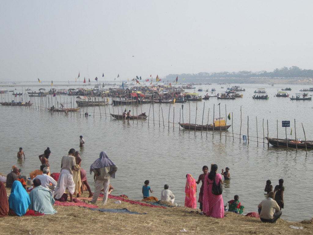 People arrive on boats by the water's edge