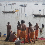A group of monks prepare to take the dip together