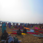 Saris are laid out to dry after people have taken the dip