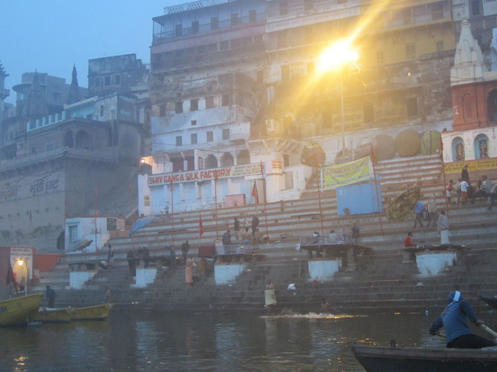 Early pilgrims take the dip from the ghats of Varanasi