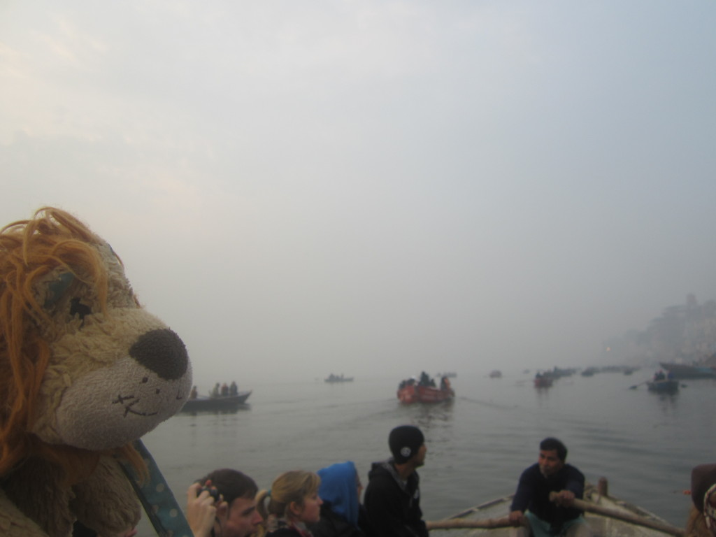 Lewis watches the rowing boats on the River Ganga
